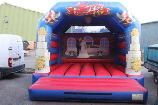 white wedding bouncy castle hire Dorset great at your wedding venue